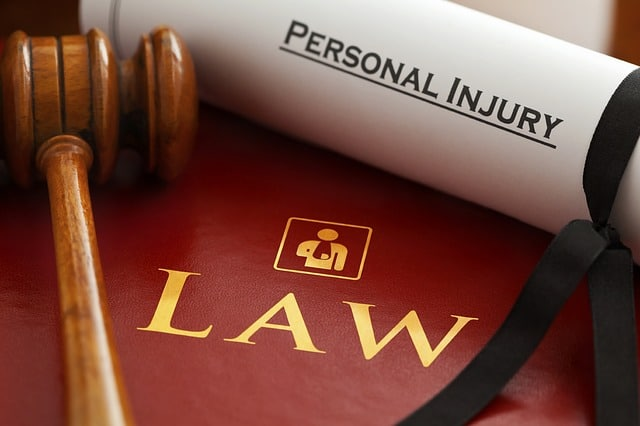 Paper with rolled up that says Personal Injury on a book with the word law on it