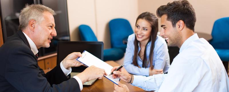 Two people happily signing an agreement with a personal injury attorney Tampa.
