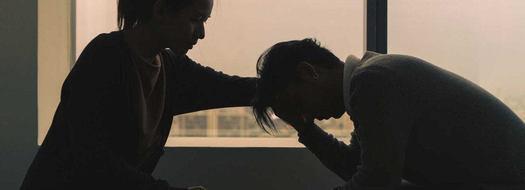 Image showing a person helping a victim of defamation.