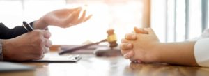 Lawyer helping client set timeline for their lawsuit