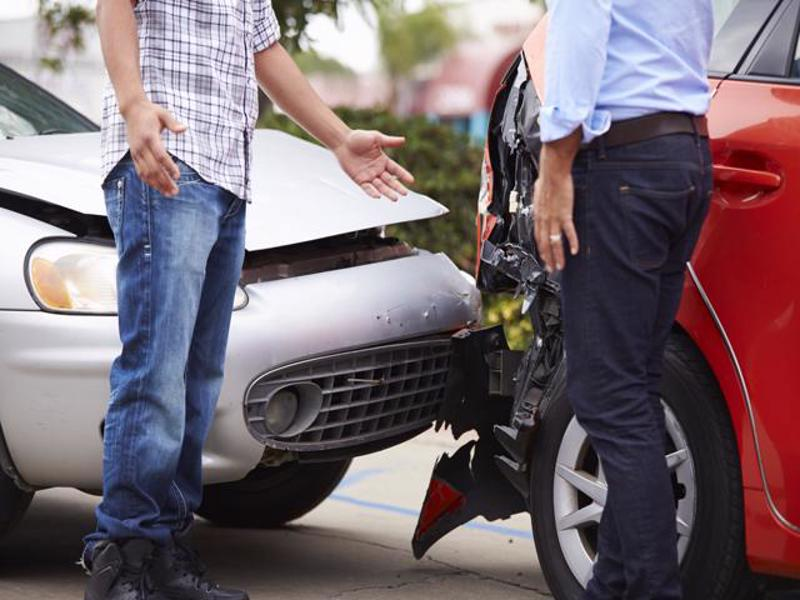 Drivers exchanging information after an accident.
