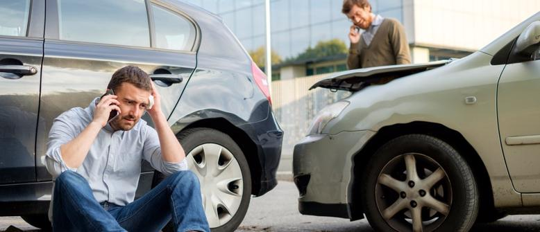 This image shows a man appearing flustered after being involved in a Car accident in Lakeland, FL