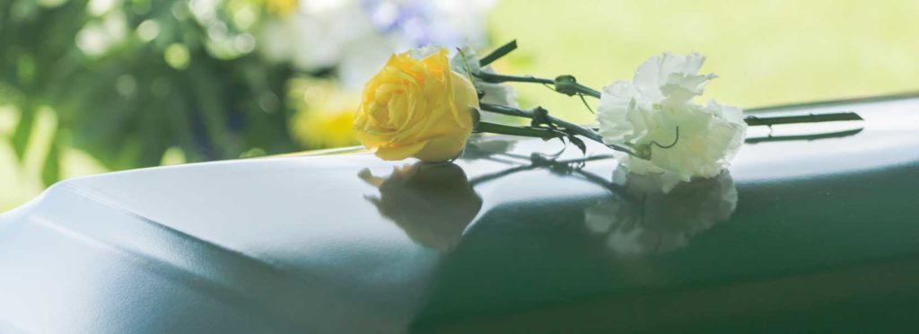Picture of a casket at a funeral