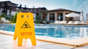 A wet floor sign beside a pool in Tampa, FL