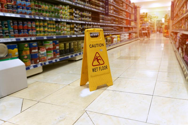 A wet floor sign in a grocery store.