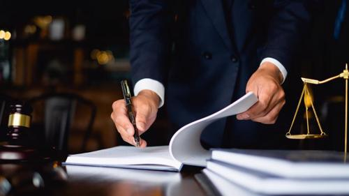 An attorney reviewing paperwork for a wrongful death claim.