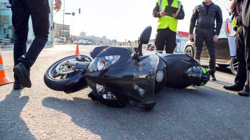 A motorcycle lying on the ground after an accident.