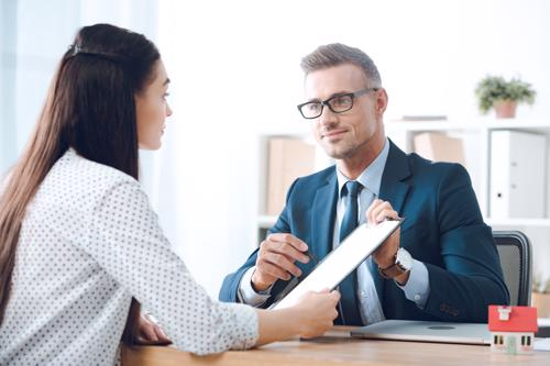 A woman meeting with a Palm Harbor personal injury lawyer.