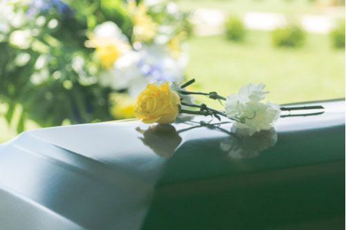 Flowers on a casket. Contact a Bartow wrongful death lawyer at Winters & Yonker.