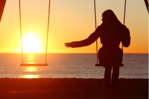 Woman on swing at sunset missing spouse. Contact an Egypt Lake-Leto wrongful death lawyer.