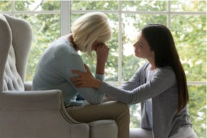Image of woman comforting crying elderly mother. Contact a Sun City Center wrongful death lawyer at Winters & Yonker..