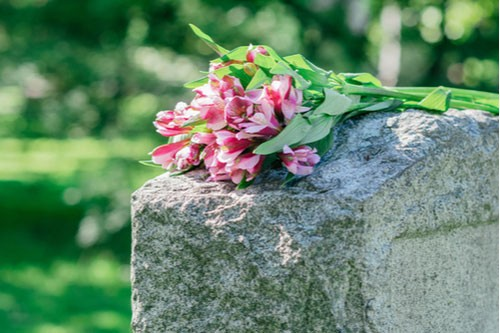 Image of flowers on headstone. Contact our Town n' Country wrongful death lawyers.