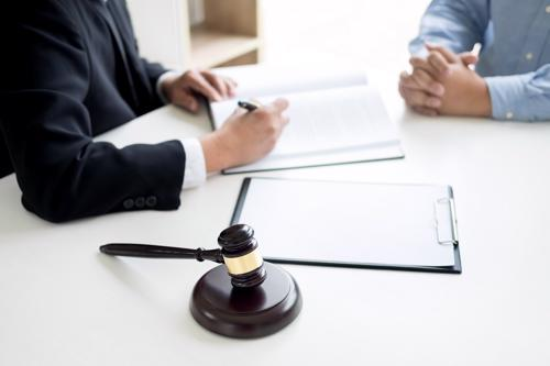 A Largo burn injury lawyer reviewing a claim with a client.