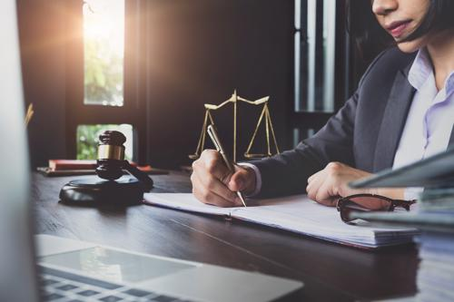 An attorney reviewing a wrongful death claim for a client.