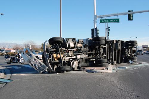 A truck on its side after an accident.