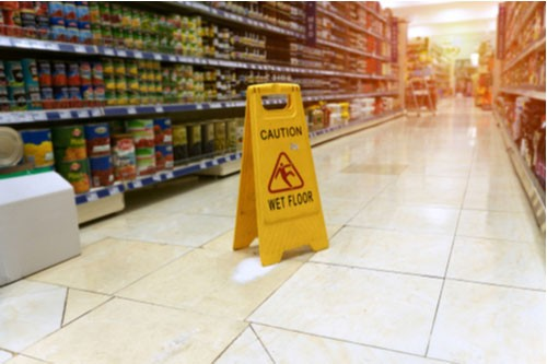 Wet floor sign, contact a Sarasota slip and fall lawyer at Winters & Yonker