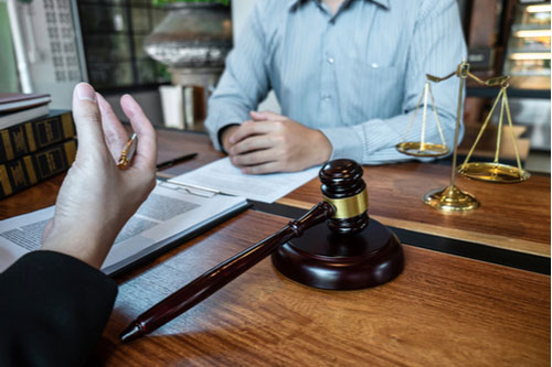 Seffner truck accident lawyer meeting with client