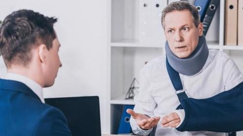 A man meeting with a Dover personal injury lawyer.