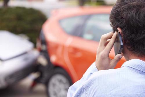 A man calling a car accident attorney in Lutz.