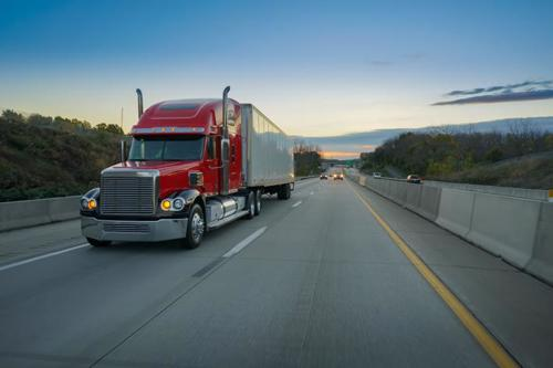 A photo of a truck on an interstate.