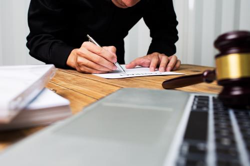 A Parrish car accident lawyer reviewing an injury claim for a client.