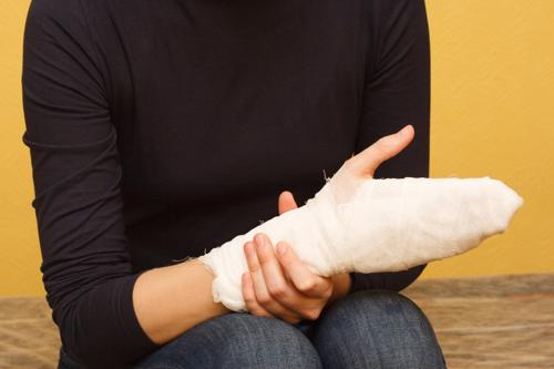 A photo of a person iwth a bandaged hand after suffering a burn injury.